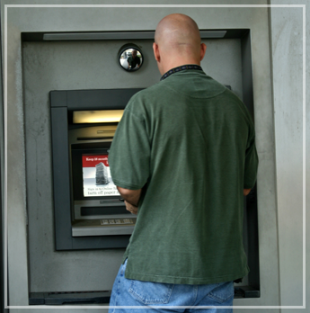 Man Using the ATM